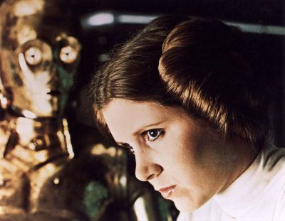 1977 Lucas film starring Carrie Fisher as Princess Leia Organa here with See Threepio played by Anthony Daniels